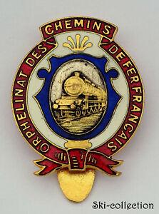 Insigne de poche Orphelinat Des Chemins de Fer Francais. Email. Vers 1920.