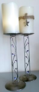 Two Pillar candle stands metal with coloured glass insets