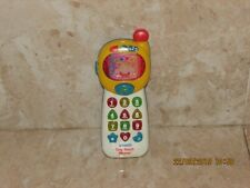 V TECH MUSICAL TINY TOUCH PHONE WITH LIGHTS