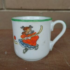 Vintage porcelain child's tea cup dogs ice hockey - no makers mark
