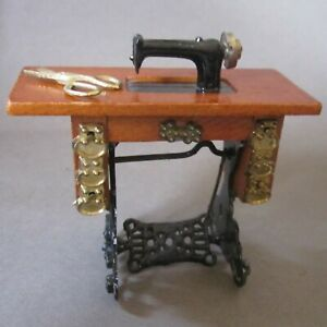 Wood and Metal Treadle Sewing Machine With Gold Tone Shears