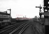 PHOTO  DMU 3 CAR SUBURBAN SET APPROACHING CARDIFF (QUEEN STREET) STATION WITH A