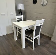 Small modern extending table with 2 chairs in white colour Kam2