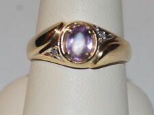 10 K Gold ring with purple gemstone and diamonds