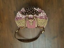 Stunning Baya Luna bag with accessorized pearls.