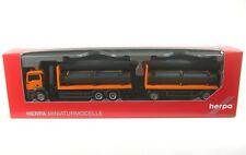 MAN TGS M Remolque de plataforma (naranja) con Grúas de carga y carga Pipa