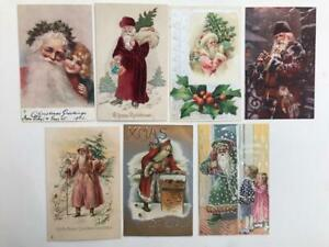 7 Christmas postcards early 1900s with Santa