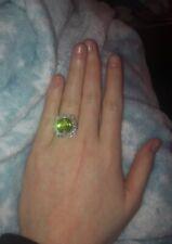 Peridot 6.61 Carat Ring 24k white gold