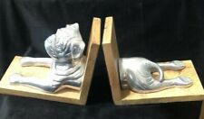 Metal Dog Bookends mounted on timber