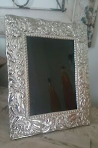 """STERLING SILVER REPOUSSE  8"""" x 10"""" PICTURE FRAME FOR  5"""" x 7"""" PHOTO."""