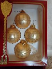 These are 4 Vintage Victoria Collection Gold Ornaments (#2672)