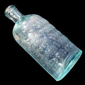 Antigue EZ Stove Polish Heavy Cast Aqua Glass Bottle Martin and Martin