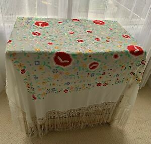 antique embroidered piano shawl with crochet and fringe border.