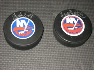 AUTOGRAPHED NEW YORK ISLANDERS HOCKEY PUCKS ( Bryan Trotter & Mike Bossy )