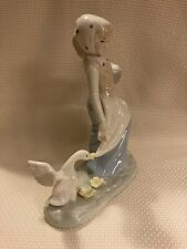 vintage woman figurine with egg basket and goose