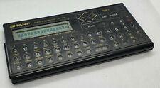 Vintage Calculator Pocket Computeur Sharp PC-1248 Bon état fonctionne OK Rare !