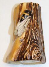 joli petite cigale sur un tronc d arbre en céramique