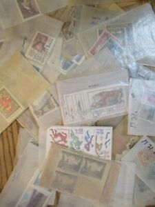 Box o Lot of worldwide stamps in packets unchecked  lot of 1306