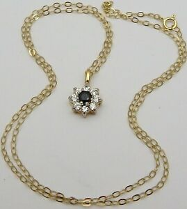 9 carat yellow gold gem set pendant 16 inch long necklace. Weighs 1.3 grams.