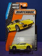 Matchbox '14 Porsche Cayman in Yellow, Collector # 1/120 Long Card.