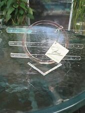 Pink acrylic earring rack holds 15 pairs of earrings..