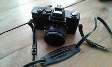 Appareil argentique Minolta SRT303b Noir avec Rokkor 50mm 1:2 Lens.
