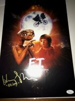 "E.T. 11x17 poster signed by Henry Thomas inscribed ""Elliott"" JSA Auth"