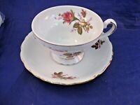 VINTAGE TEA CUP AND SAUCER - DELICATE ROSE DECORATION AND EMBOSSED EDGES