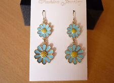Goudkleurige lange oorbellen met blauwe bloemen madeliefjes NIEUW