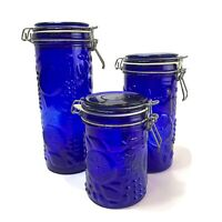 SET OF 3 DEEP COBALT BLUE EMBOSSED WITH FRUIT GLASS CANISTERS  WIRE BAIL LIDS