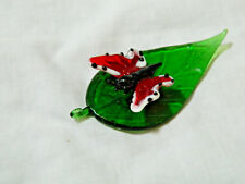 Hand Blown Glass Figure of a Red And White Butterfly On A Glass Elm Leaf