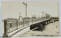RPPC Winneconne Wisconsin The Bridge with U.S. Flags Real Photo Postcard L9