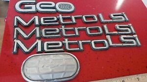 Used OEM Geo Metro/Convertible 1989-1994 complete Emblem Badge Nameplate set 8pc