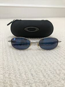 Oakley Metal framed Blue Lenses Sunglasses