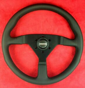 Genuine Momo Monte Carlo black leather 350mm steering wheel with horn button.