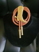 One is new, and one is used. 2 Brown Leather Bolo With Gold Boot.
