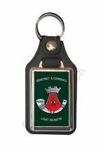 SOMERSET & CORNWALL LIGHT INFANTRY CAP BADGE ON A LEATHER STYLE KEY RING.