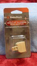 RADIO SHACK 4-PIN RJ-11/RJ-14 TWO OUTLET MODULAR TELEPHONE PLUG ADAPTER 279-018