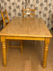 Solid wooden dining table and 6 chairs (1 chair cover slightly damaged).