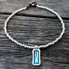 collar de cuero zamak con cristal azul tienda 50 y uno