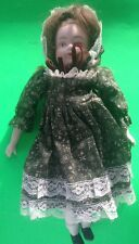 50+/- YEAR OLD PORCELAIN & CLOTH DOLL WITH GREEN DRESS AND BONNET