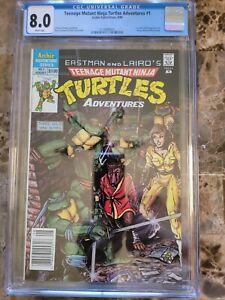 Teenage Mutant Ninja Turtles Adventures #1 CGC 8.0 NEWSSTAND AND WHITE!!! HOT 🔥