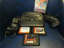 Sega Genesis Bundle with games, power supply, video cable, and one controller