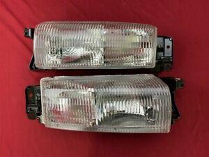 NOS OEM Oldsmobile Achieva Headlamp Light 1992 - 1998 Pair