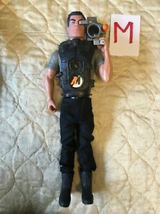 Action Man with camera (M)