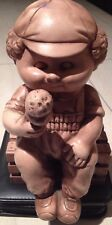 Figurine kid boy eating ice cream sitting on a bench collectibles vintage Rare