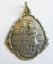 Antique Art Nouveau German Silver Repoussé Sweethearts on Fence Charm or Pendant