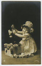 c 1910 Cute Children Child ADORABLE LITTLE GIRL w/ Box of Flowers photo postcard