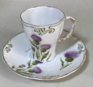 ANTIQUE R & C ROSENTHAL CUP AND SAUCER THISTLE FLORAL