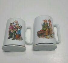 Norman Rockwell Toy Maker Cobbler set of 2 Collectible Mug Gold Rim